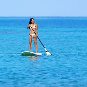 Paddleboarding beach woman on stand up paddleboard surfboard surfing in ocean sea on Big Island, Haw