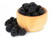 Sweet blackberries in bowl isolate on white