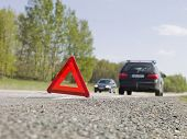 Warning triangle in front of a car breakdown