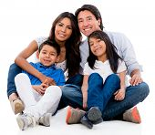 Beautiful family portrait looking happy - isolated over white background