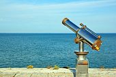 Telescope pointed at the ocean, what perspective of future?