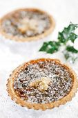 christmas  tart with mincemeat and candied peel on white snow festive background