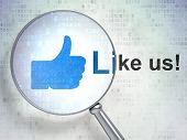 Social media concept: Like and Like us! with optical glass