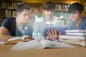 Concentrated young men studying medicine together with futuristic interface in university library