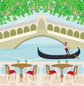 stock photo of gondolier  - cafe in Venice gondola in the background  - JPG