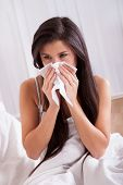 Woman Ill In Bed With A Cold And Flu