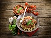 spaghetti bolognese with ragout sauce and parmesan cheese