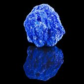 Blue Azurite mineral stone, with reflection on black surface background