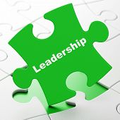 Business concept: Leadership on puzzle background