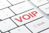 SEO web development concept: VOIP on computer keyboard background