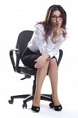 image of hush  - Business woman is sitting and doing hush sign with glasses - JPG