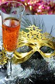 Glasse in festive tinsel tinsel and mask