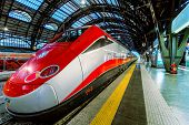 MILAN, ITALY - JUNE 07, 2012: Trenitalia Frecciarossa (red arrow) on Milan Central Station. This hig