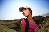 Brunette girl on a hiking day with backpack