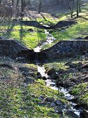 stream and stone spillway