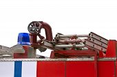 foto of ladder truck  - Back end of a red fire truck with a ladder - JPG