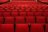 Red Chairs in movie theater.