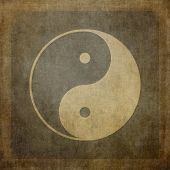 Yin yang symbol on vintage, textured background.