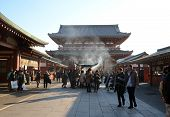 Tokyo, Japan - Nov 21: Buddhists Gather Around A Fire To Light Incense And Pray At Sensoji Temple