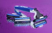 Men shaver on purple background