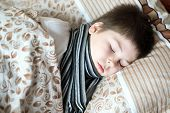 Boy With Sick Throat Asleep In Bed