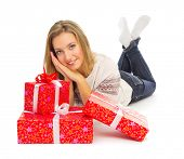 Young smiling girl with gift boxes isolated