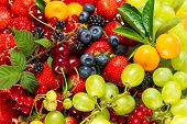 Mix Of Fresh Fruits And Berries. Raw Food Ingredients