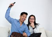 Young Couple Watching Television At Home