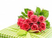 Bouquet Of Fresh Pink Roses With Gift Isolated On White