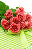 Fresh Pink Roses With Gift Over White Background