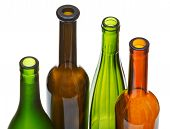 Four Open Bottlenecks Of Colored Wine Bottles