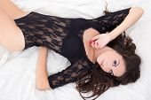 Young Sexy Charming Woman In Black Lace Lingerie Lying