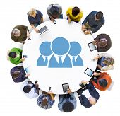 Group of People Using Digital Devices with Teamwork Concept