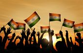 Group of People Waving Indian Flags in Back Lit