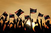 Group of People Waving Flag of Thailalnd in Back Lit