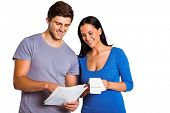Young couple reading their bills on white background