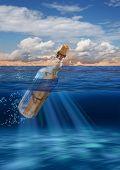 Message In Bottle Floating On Open Sea
