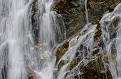 Close Up Of A Waterfall Against A Stone Wall Background