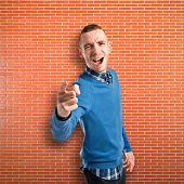 Angry Man Shouting Over Bricks Background