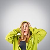 Young Girl Doing Surprise Gesture Over Grey Background