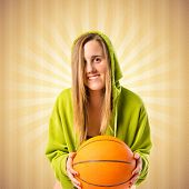 Young Girl With Basketball Over Pop Background