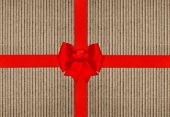 Red Ribbon Bow On Cardboard Paper Texture