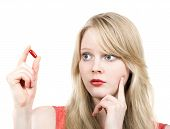 Young Blond Girl Afraid With Medicine Pill