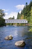 foto of mckenzie  - The historic Goodpasture covered bridge outside of Eugene Oregon under brilliant blue early fall sky - JPG