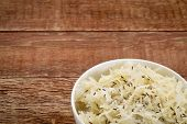 sauerkraut with caraway seeds - a small bowl on a rustic barn wood table
