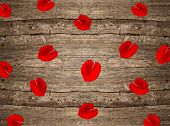 Red Rose Petals On Wooden Background