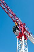 picture of boom-truck  - A Construction crane against the blue sky - JPG