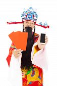 God Of Wealth Holding Red Envelope And Mobile Phone.