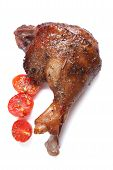Roasted Duck Leg And Cherry Tomatoes Isolated On White