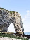 Rock With Arch On English Channel Beach